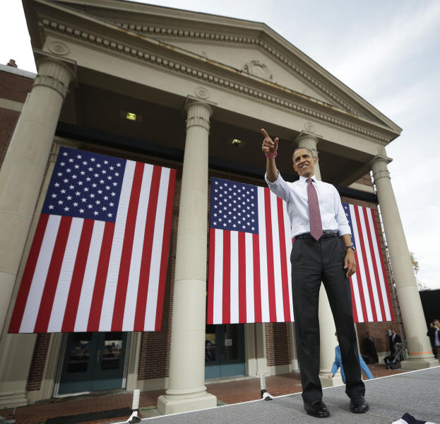 President Barack Obama points towards supporters after speaking at a campaign event at Elm Street Middle School, Saturday, Oct. 27, 2012 in Nashua, N.H. (AP Photo/Pablo Martinez Monsivais)