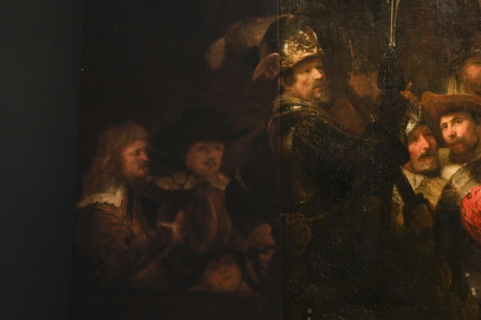 Detail of the Night Watch's left side, showing how Rembrandt's biggest painting just got bigger with the help of artificial intelligence in Amsterdam, Netherlands, Wednesday, June 23, 2021. The Dutch national museum and art gallery reveals findings from a long-term project to examine in minute detail Rembrandt van Rijn's masterpiece the Night Watch. (AP Photo/Peter Dejong)
