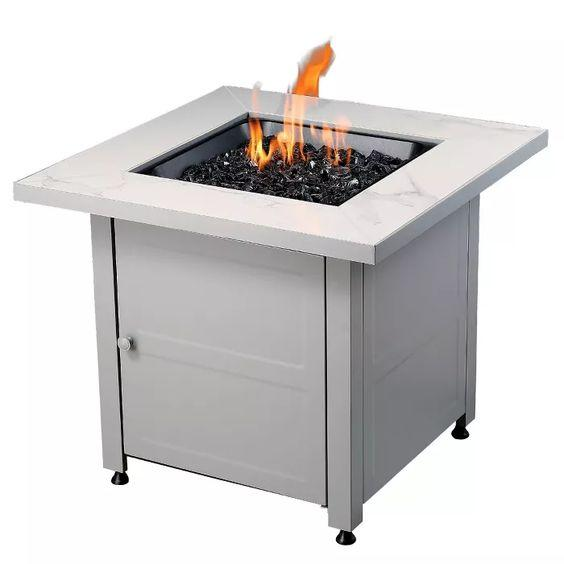 """We <em>love</em> the faux <a href=""""https://www.architecturaldigest.com/story/scraps-of-marble-and-stone-make-for-excellent-diys?mbid=synd_yahoo_rss"""">marble</a> top surrounding this open flame. This all-weather fire pit adds ambiance and warmth, and will make a stylish addition to any backyard. $200, Target. <a href=""""https://www.target.com/p/endless-summer-30-inch-gas-fire-pit-table-with-cover-black-glass/-/A-76021388"""">Get it now!</a>"""