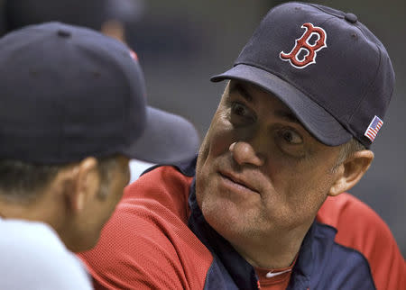 Boston Red Sox manager John Farrell (R) talks with bench coach Torey Lovullo (L) in the dugout during the first inning of their MLB American League baseball game against the Tampa Bay Rays in St. Petersburg, Florida, September 11, 2013. REUTERS/Steve Nesius
