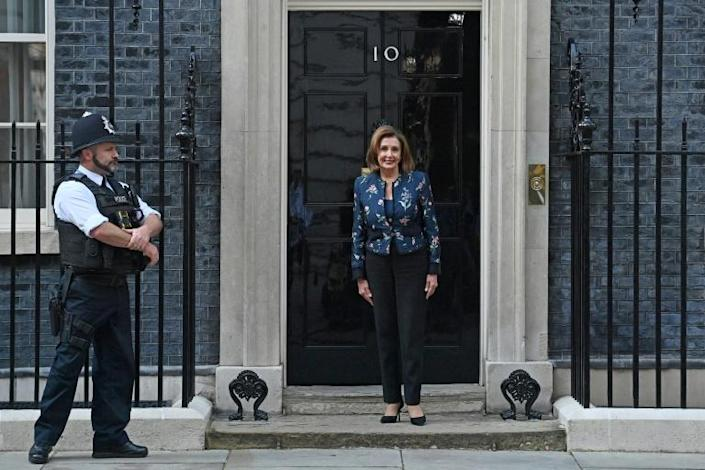Nancy Pelosi, Speaker of the US House of Representatives, posed for media outside of 10 Downing Street on Thursday as she arrived for a meeting with Britain's Prime Minister Boris Johnson (AFP/JUSTIN TALLIS)
