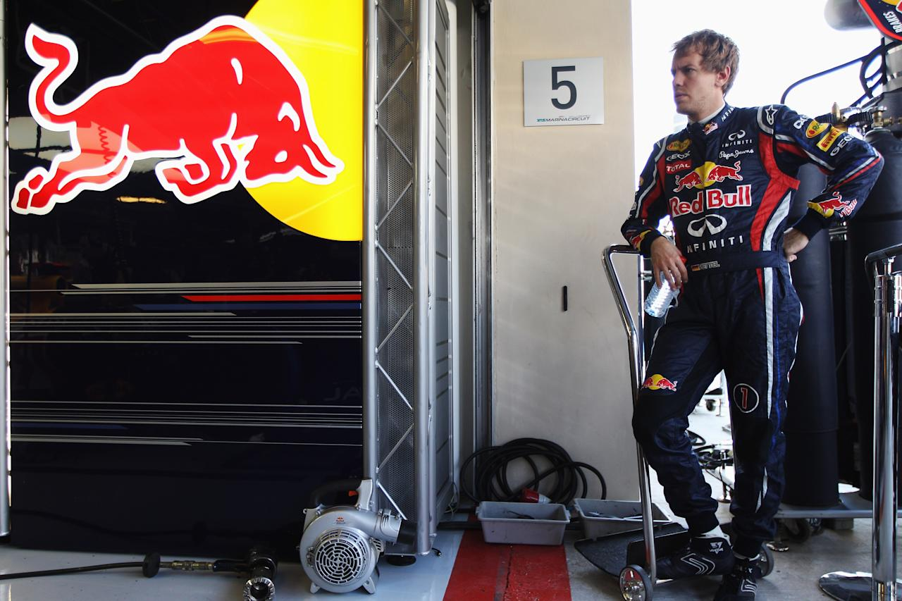 ABU DHABI, UNITED ARAB EMIRATES - NOVEMBER 12:  Sebastian Vettel of Germany and Red Bull Racing prepares to drive during the final practice session prior to qualifying for the Abu Dhabi Formula One Grand Prix at the Yas Marina Circuit on November 12, 2011 in Abu Dhabi, United Arab Emirates.  (Photo by Mark Thompson/Getty Images)