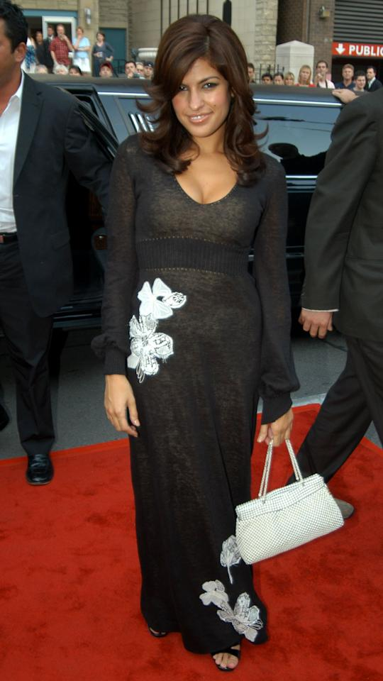 <p>At the 2003 Toronto Film Festival, the actress kept her look simple on the red carpet. She donned a black v-neck maxi dress with what floral appliqué on the waist and hemline.</p>