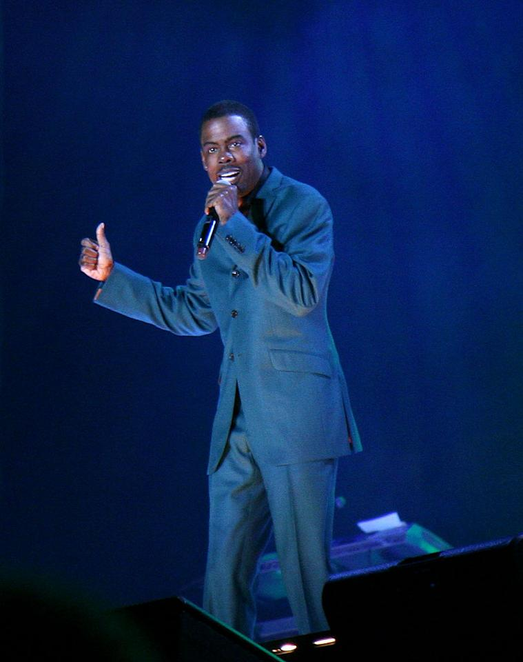 "Comedian Chris Rock makes the crowd cackle during the final day of the star-studded festival. Johnny Nunez/<a href=""http://www.wireimage.com"" target=""new"">WireImage.com</a> - July 6, 2008"