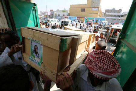 FILE PHOTO: Mourners carry the coffin of a victim who killed by shells that hit a house in Hodeidah, Yemen December 10, 2018. Picture taken December 10, 2018. REUTERS/Abduljabbar Zeyad/File Photo