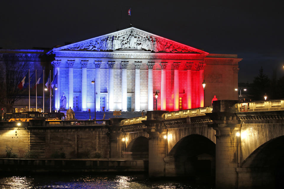 France's National Assembly is lit with the blue, white and red colours of the French flag in Paris. Photo: Charles Platiau/Reuters