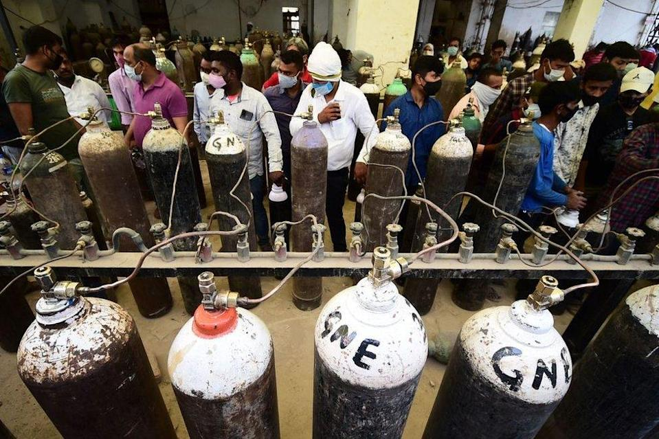 Relatives of Covid patients have been queuing up in cities to refill cylinders