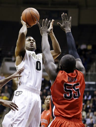 Purdue guard Terone Johnson (0) shoots over Ball State forward Majok Majok in the first half of an NCAA college basketball game in West Lafayette, Ind., Tuesday, Dec. 18, 2012. (AP Photo/Michael Conroy)