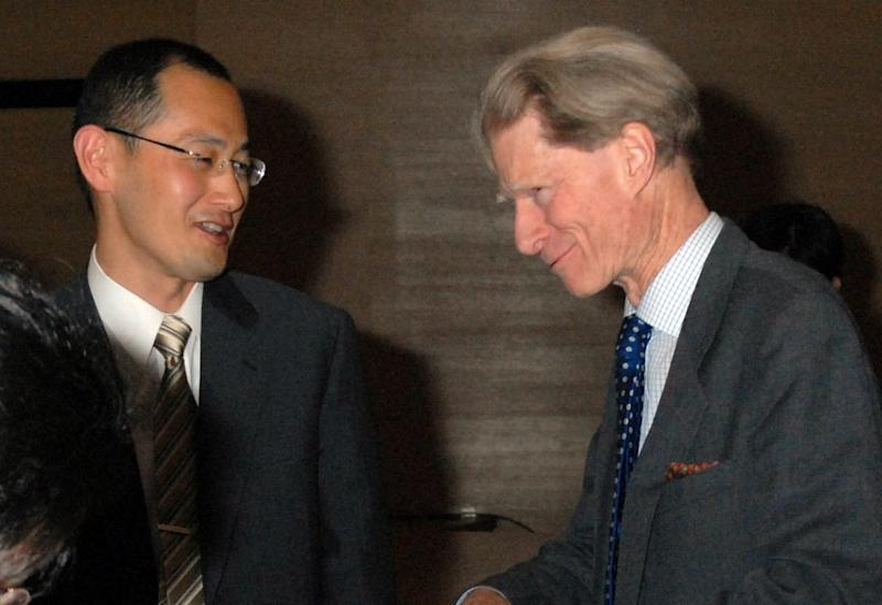 In this April, 2008 photo, Kyoto University Professor Shinya Yamanaka, left, and British researcher John Gurdon exchange words as they attend a symposium on induced pluripotent stem cell in Tokyo. Gurdon and Yamanaka of Japan won this year's Nobel Prize in physiology or medicine on Monday, Oct. 8, 2012 for discovering that mature, specialized cells of the body can be reprogrammed into stem cells - a discovery that scientists hope to turn into new treatments. (AP Photo/Kyodo News) JAPAN OUT, MANDATORY CREDIT, NO LICENSING IN CHINA, FRANCE, HONG KONG, JAPAN AND SOUTH KOREA