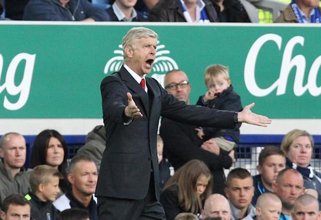 Arsenal manager Arsene Wenger during his side's Premier League match against Everton at Goodison Park on August 23, 2014 (AFP Photo/Lindsey Parnaby)