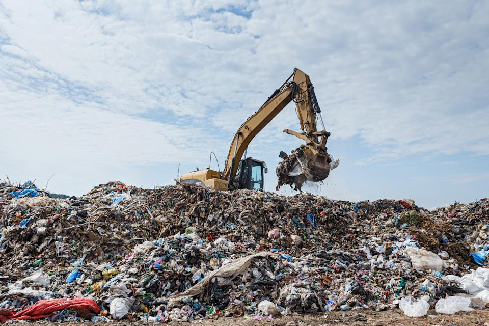 An excavator turns around the mounds of waste at the Uzhhorod landfill, Uzhhorod, western Ukraine, June 22, 2019.  The 20-year-old landfill for domestic solid waste has almost reached its limit. The layer of litter here reaches 18 metres (59 feet) with seven metres (23 feet) of refuse buried underground. However, several dozens of people keep the situation at bay as they scour waste for recyclables. Ukrinform. (Photo credit should read Serhii Hudak / Barcroft Media via Getty Images)