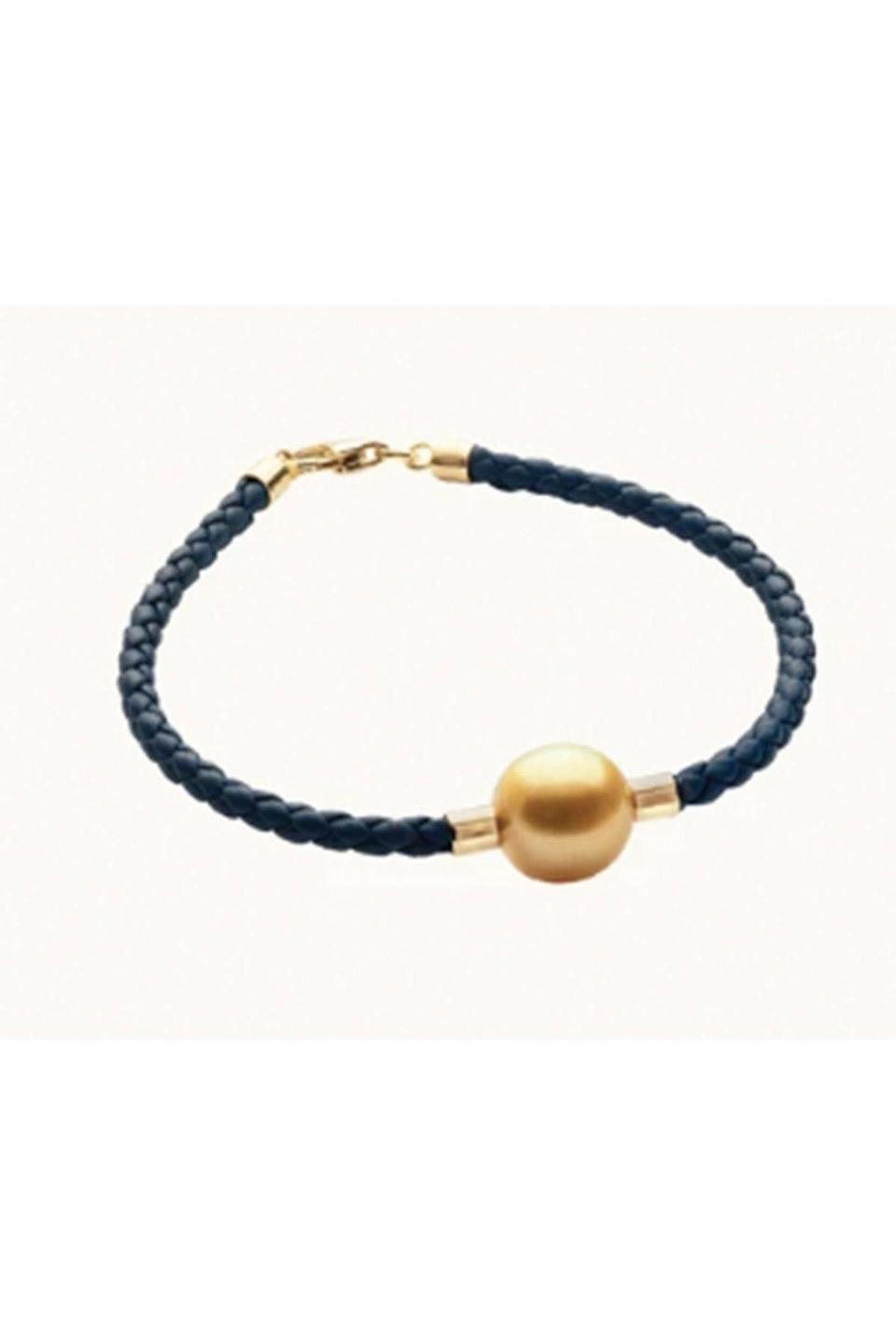 """<p><strong>Jewelmer</strong></p><p>jewelmer.com</p><p><strong>$650.00</strong></p><p><a href=""""https://us.jewelmer.com/collections/for-him/products/leather-bracelet-b"""" rel=""""nofollow noopener"""" target=""""_blank"""" data-ylk=""""slk:Shop Now"""" class=""""link rapid-noclick-resp"""">Shop Now</a></p><p>Golden pearls, found in the South Sea oyster, come by their sunny luster naturally, which makes them extremely rare. Balanced by a casual braided leather strap, this bracelet is proof that extraordinary things can be worn every day. </p>"""