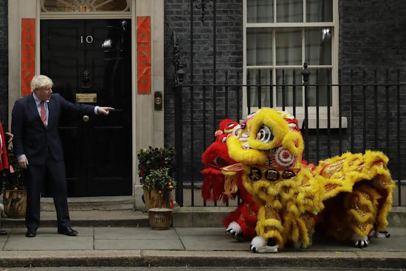 Boris Johnson greeted the Chinese Lions outside Downing Street on Friday: AP
