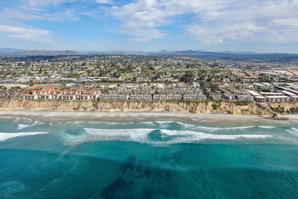 Aerial view of condo community next to the beach and sea in south california