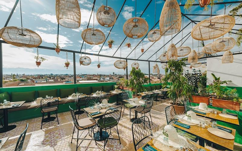 L'Mida is a groovy, emerald green rooftop restaurant that offers modern takes on Moroccan classics