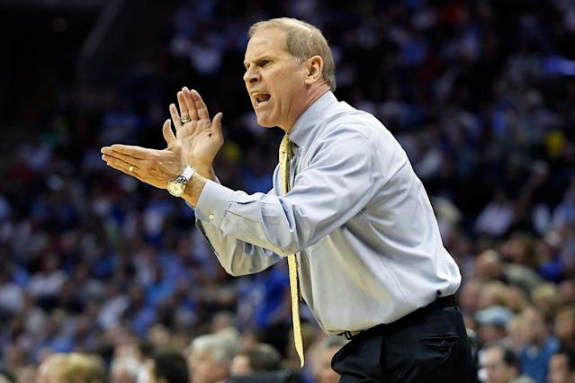 Head coach John Beilein of the Michigan Wolverines reacts in the first half while taking on the Duke Blue Devils during the third round of the 2011 NCAA men's basketball tournament at Time Warner Cable Arena on March 20, 2011 in Charlotte, North Carolina. (Photo by Kevin C. Cox/Getty Images)