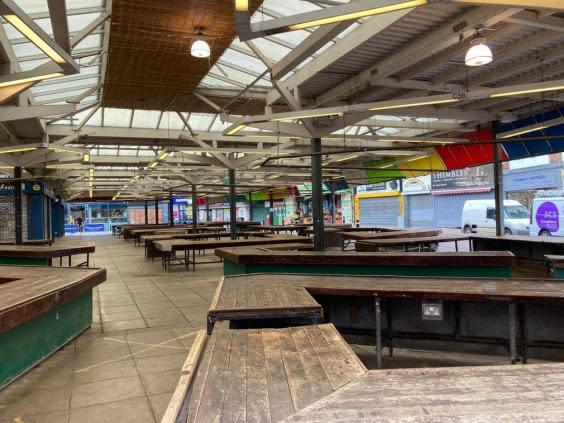 An empty Leicester Market – though some businesses are continuing to trade (Samuel Lovett)