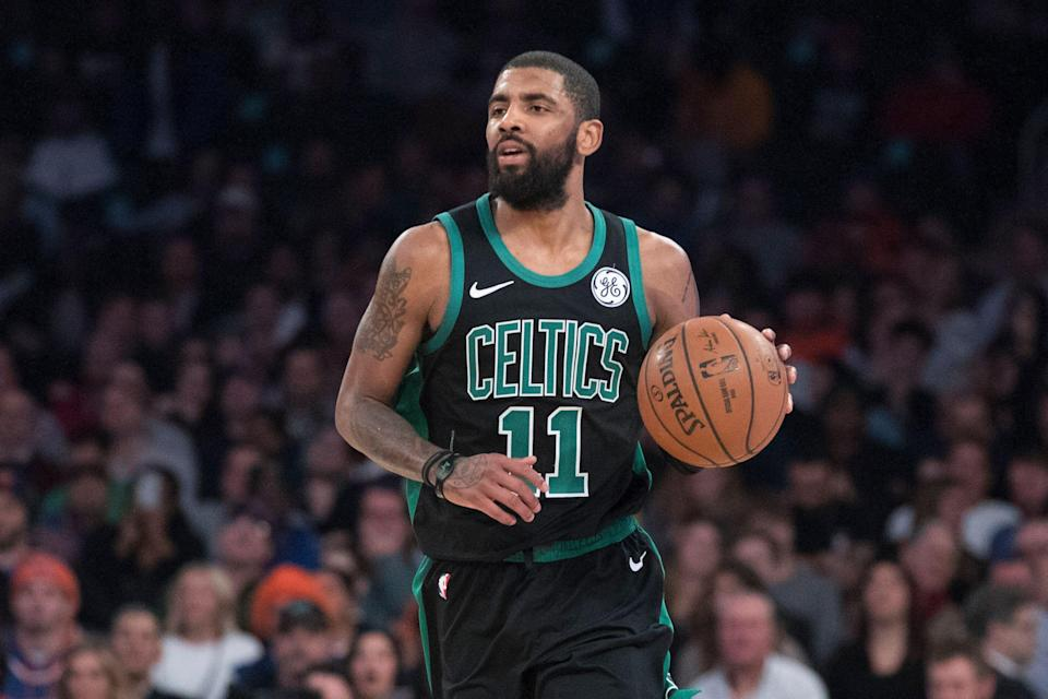 Boston Celtics guard Kyrie Irving handles the ball during the second half of an NBA basketball game against the New York Knicks, Friday, Feb. 1, 2019, at Madison Square Garden in New York. The Celtics won 113-99. (AP Photo/Mary Altaffer)