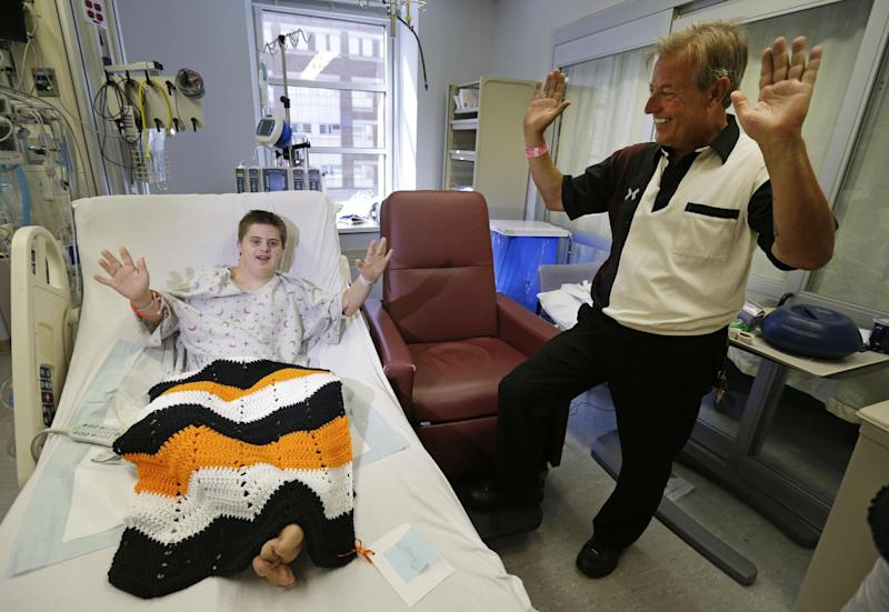 Daniel Borowy, left, pretends to dance to a Lady Gaga song alongside his father, Milton, in his hospital room in Baltimore, Monday, Sept. 10, 2012. Borowy was preparing to leave the hospital and head home for the first time since being critically injured after he was shot by a classmate at a suburban Baltimore school on Aug. 27. (AP Photo/Patrick Semansky)