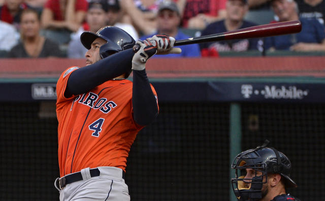 Houston Astros' George Springer hits a solo home run in the eighth inning during Game 3 of a baseball American League Division Series against the Cleveland Indians, Monday, Oct. 8, 2018, in Cleveland. (AP Photo/Phil Long)