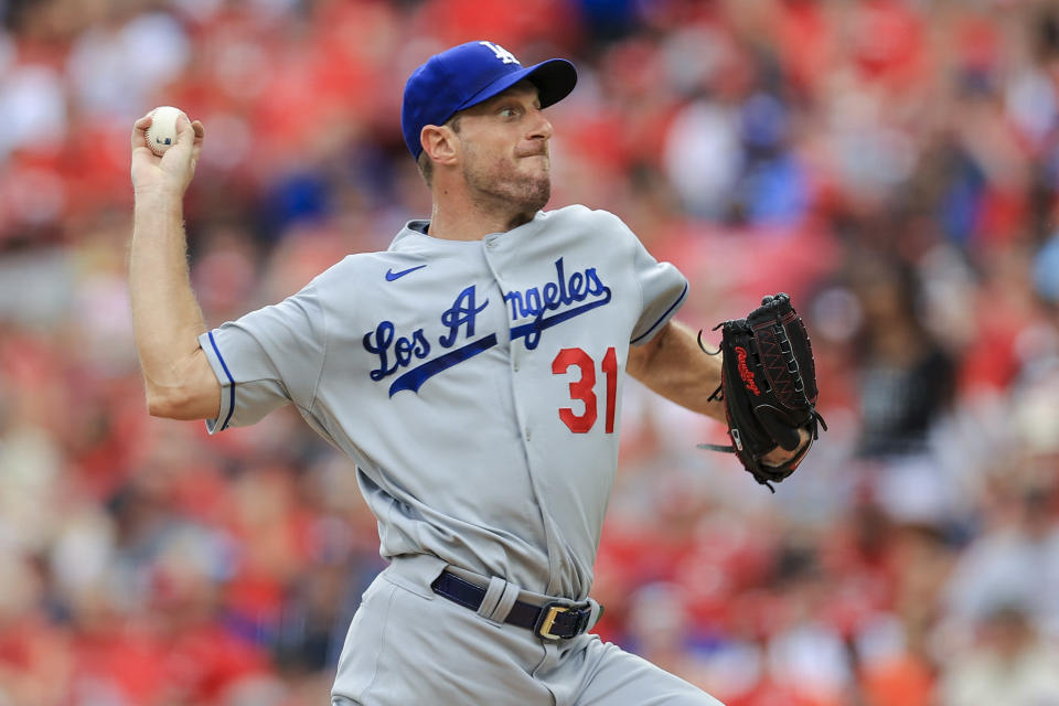 Los Angeles Dodgers' Max Scherzer throws during the sixth inning of a baseball game against the Cincinnati Reds in Cincinnati, Saturday, Sept. 18, 2021. (AP Photo/Aaron Doster)