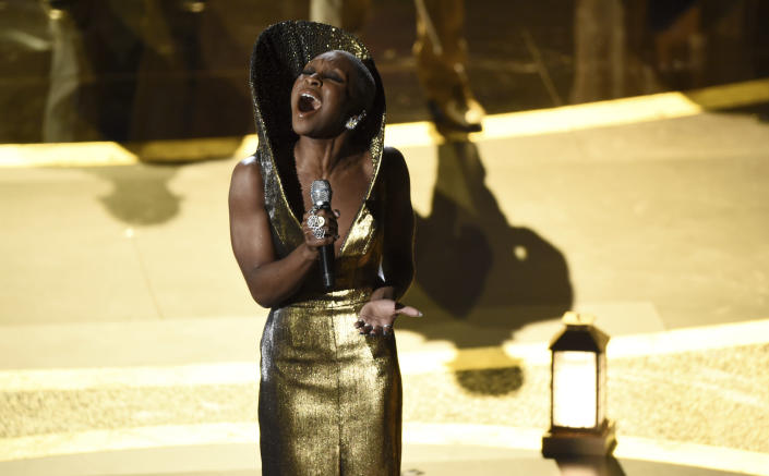 """Cynthia Erivo performs """"Stand Up"""" nominated for the award for best original song from """"Harriet"""" at the Oscars on Sunday, Feb. 9, 2020, at the Dolby Theatre in Los Angeles. (AP Photo/Chris Pizzello)"""