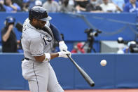Tampa Bay Rays' Yandy Diaz hits a double in the first inning in the first inning of a baseball game against the Toronto Blue Jays in Toronto on Wednesday, Sept. 15, 2021. (Jon Blacker/The Canadian Press via AP)