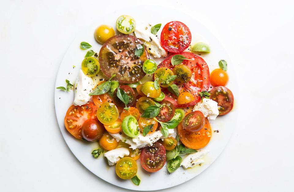 "When tomatoes are so ripe that you can smell them before you see them at the farmers market, this is the dish to make. Once you plate it, it's a good idea to let it sit for a few minutes to give the tomatoes a chance to release their juices. <a href=""https://www.epicurious.com/recipes/food/views/ultimate-caprese-salad?mbid=synd_yahoo_rss"" rel=""nofollow noopener"" target=""_blank"" data-ylk=""slk:See recipe."" class=""link rapid-noclick-resp"">See recipe.</a>"