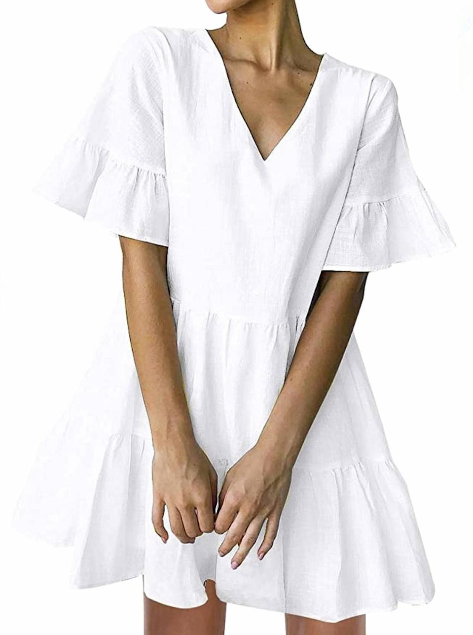 """We love the silhouette of this ruffly short sleeve pick—the statement sleeves will bring pure spring energy and optimism to your closet. Offset the spritely vibe with a pair of Dr. Martens and a crossbody bag. $20, Amazon. <a href=""""https://www.amazon.com/FANCYINN-Womens-Pockets-Sleeve-Ruffle/dp/B07Q64T78B/"""" rel=""""nofollow noopener"""" target=""""_blank"""" data-ylk=""""slk:Get it now!"""" class=""""link rapid-noclick-resp"""">Get it now!</a>"""