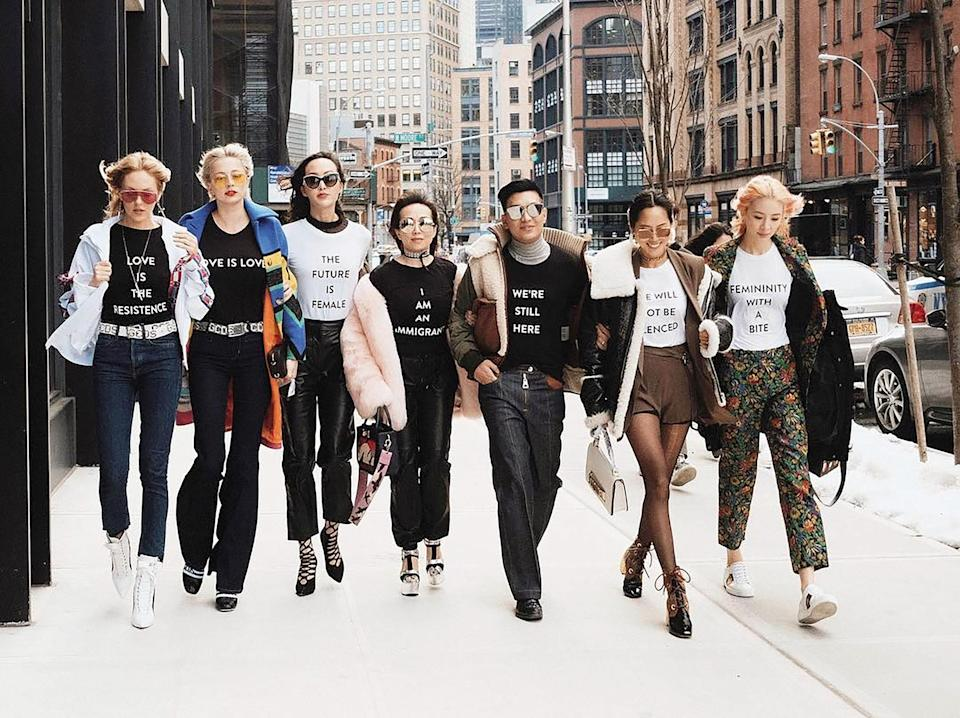 Aimee Song and other fashion influencers wearing Prabal Gurung's political statement T-shirts during NYFW photographed in her book <em>Aimee Song: World of Style</em>. (Photo: Reproduced with permission from <em>Aimee Song: World of Style</em>; Abrams; 2018)