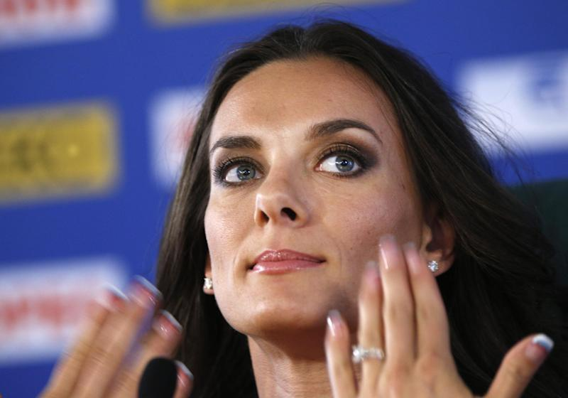 Russia's Yelena Isinbayeva, the gold medalist in the women's pole vault, gestures during a press conference at the World Athletics Championships in the Luzhniki stadium in Moscow, Russia, Thursday, Aug. 15, 2013. (AP Photo/Alexander Zemlianichenko)