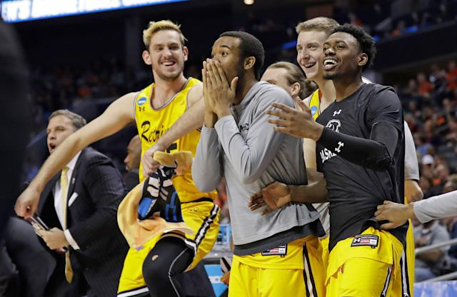 UMBC players celebrate during their historic win over Virginia in the first round of the 2018 NCAA men's college basketball tournament in Charlotte, N.C. (AP)