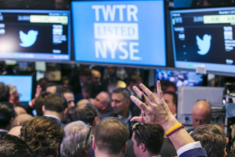 A trader raises his hand just before the Twitter Inc. IPO begins on the floor of the New York Stock Exchange in New York, November 7, 2013.