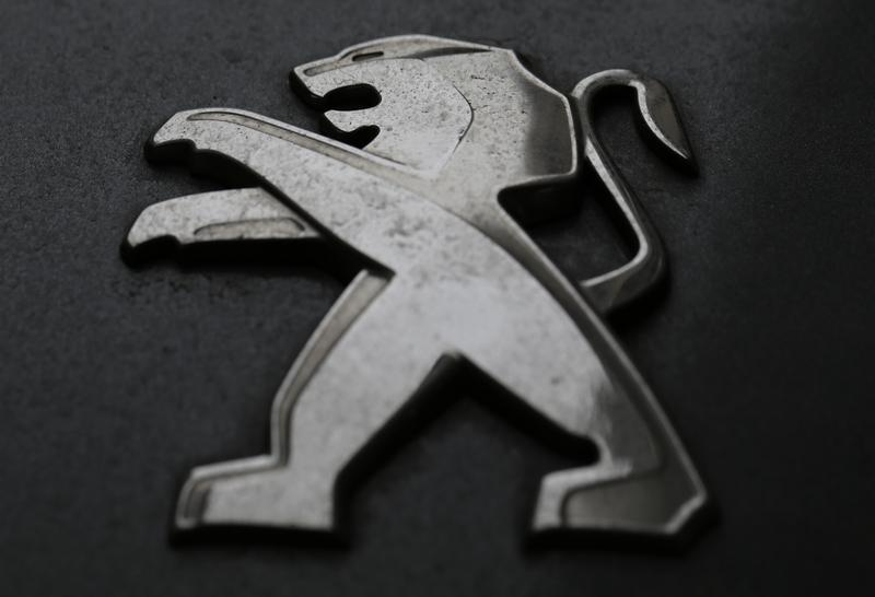 A company logo is seen on a Peugeot car parked in Paris