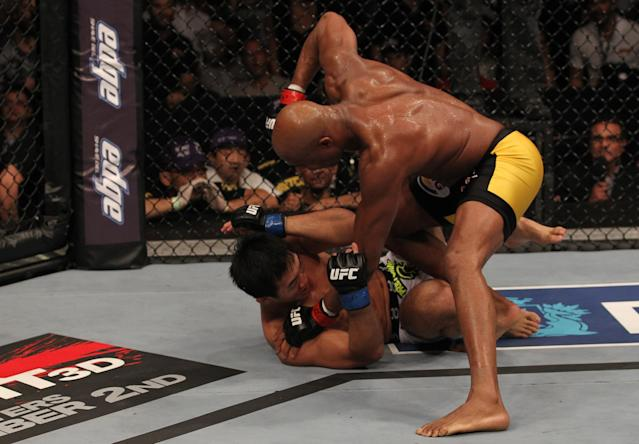 RIO DE JANEIRO, BRAZIL - AUGUST 27: (R-L) Anderson Silva finishes off Yushin Okami with punches on the ground in the UFC Middleweight Championship bout at UFC 134 at HSBC Arena on August 27, 2011 in Rio de Janeiro, Brazil. (Photo by Al Bello/Zuffa LLC/[Zuffa LLC via Getty Images)