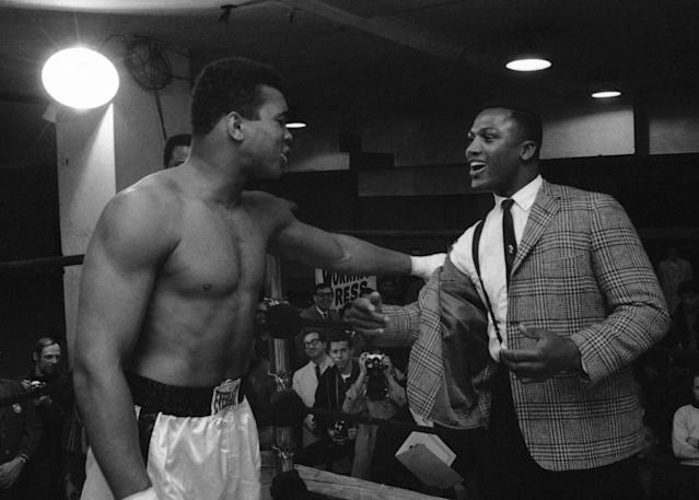 FILE - In this March 15, 1967, file photo, Joe Frazier, right, a heavyweight boxer and a contender for champion Muhammad Ali's (Cassius Clay) title, is kidded by Clay at the champion's training quarters at Madison Square Garden in New York. Frazier, the former heavyweight champion who handed Muhammad Ali his first defeat yet had to live forever in his shadow, died Monday Nov. 7, 2011, after a brief final fight with liver cancer. He was 67. (AP Photo/John Rooney, File)