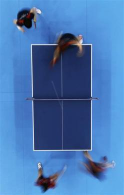 Japan's Kasumi Ishikawa and Ai Fukuhara plays against Erica Wu and Lily Zhang of the U.S. in their women's team first round table tennis match at the ExCel venue during the London 2012 Olympic Games August 3, 2012.