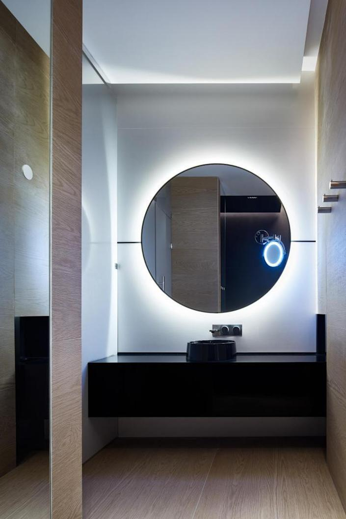 A bathroom vanity inside the Gagarin International Airport's new VIP Lounge, characterized by round shapes and sleek white surfaces.
