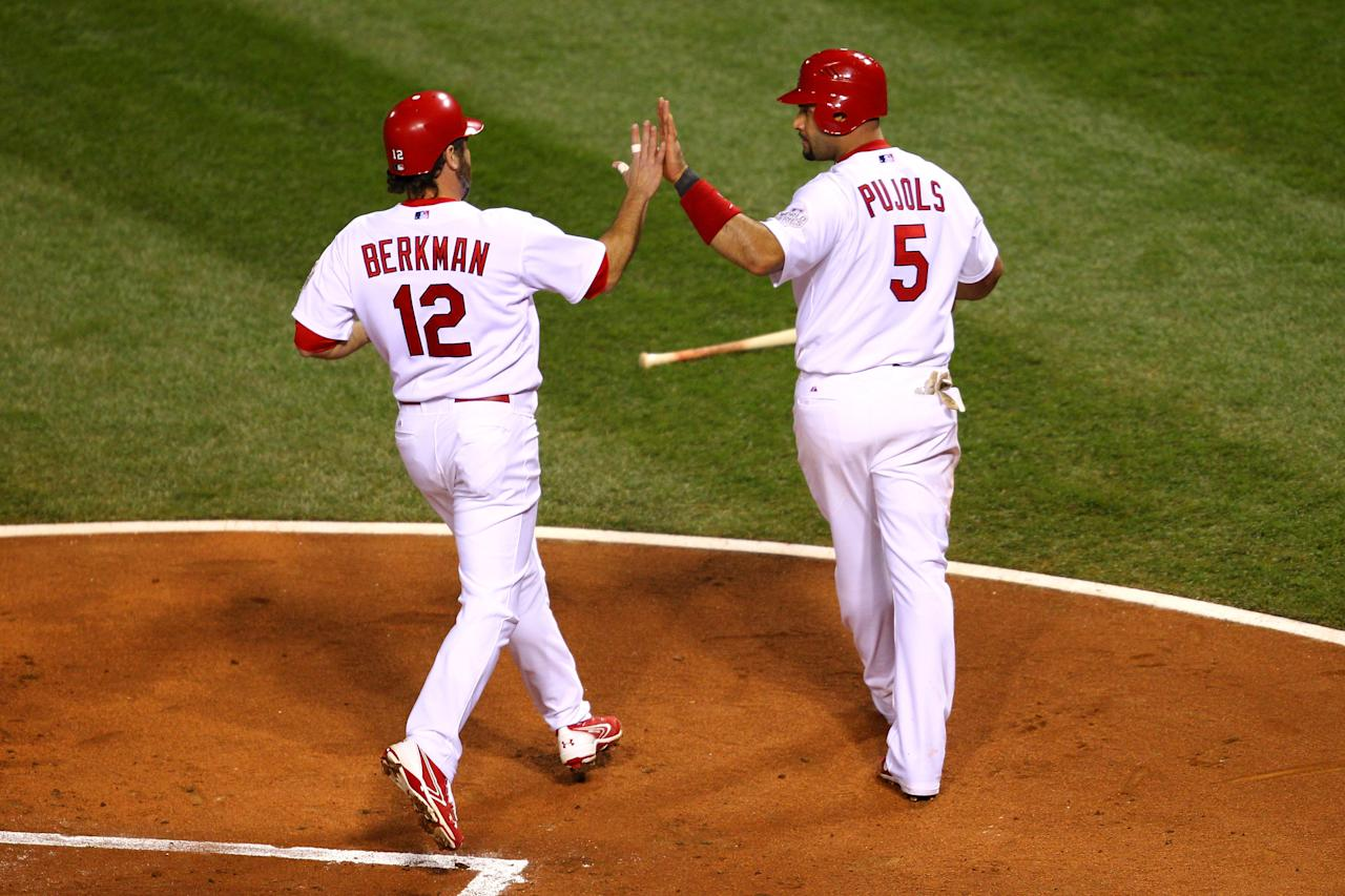 ST LOUIS, MO - OCTOBER 28:  Albert Pujols #5 (R) and Lance Berkman #12 of the St. Louis Cardinals celebrate after scoring on a two-run double by David Freese #23 in the first inning during Game Seven of the MLB World Series against the Texas Rangers at Busch Stadium on October 28, 2011 in St Louis, Missouri.  (Photo by Dilip Vishwanat/Getty Images)