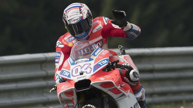 Marc Marquez attempted a bold pass at the final corner, but Andrea Dovizioso held on to win the Austrian MotoGP.