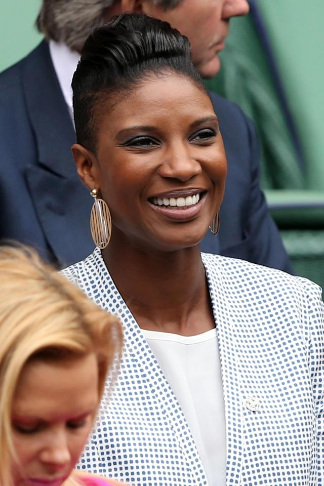 LONDON, ENGLAND - JUNE 24: Denise Lewis watches the gentlemen's singles match between Victor Hanescu of Romania and Roger Federer of Switzerland on day one of the Wimbledon Lawn Tennis Championships at the All England Lawn Tennis and Croquet Club on June 24, 2013 in London, England. (Photo by Clive Brunskill/Getty Images)