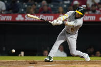 Oakland Athletics' Jed Lowrie grounds out during the seventh inning of a baseball game against the Los Angeles Angels Friday, Sept. 17, 2021, in Anaheim, Calif. (AP Photo/Ashley Landis)