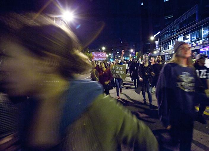 <p>Protesters march down Monroe Ave. NW in Grand Rapids, Mich., Thursday, Nov. 10, 2016, in opposition of Donald Trump's presidential election victory. (Photo: Cory Morse/The Grand Rapids Press via AP) </p>