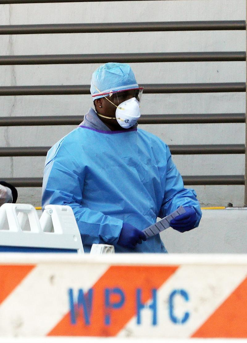 A medical worker walks out of a coronavirus screening tent set up outside the emergency room at White Plains Hospital on March 21.