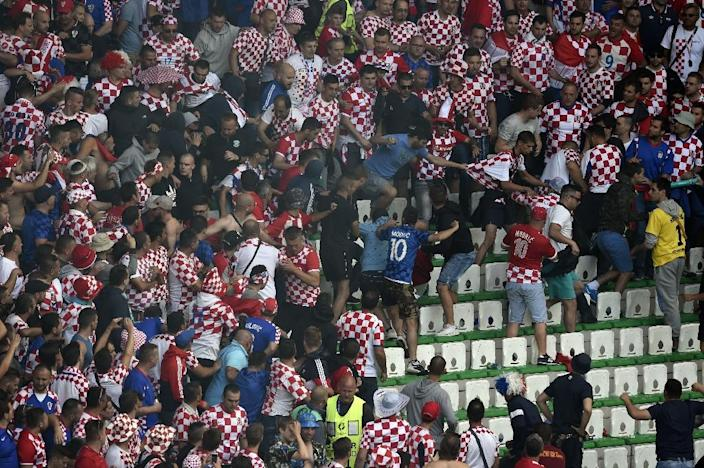 A fight breaks out during the Euro 2016 group D match between Czech Republic and Croatia (AFP Photo/Jean-Philippe Ksiazek )