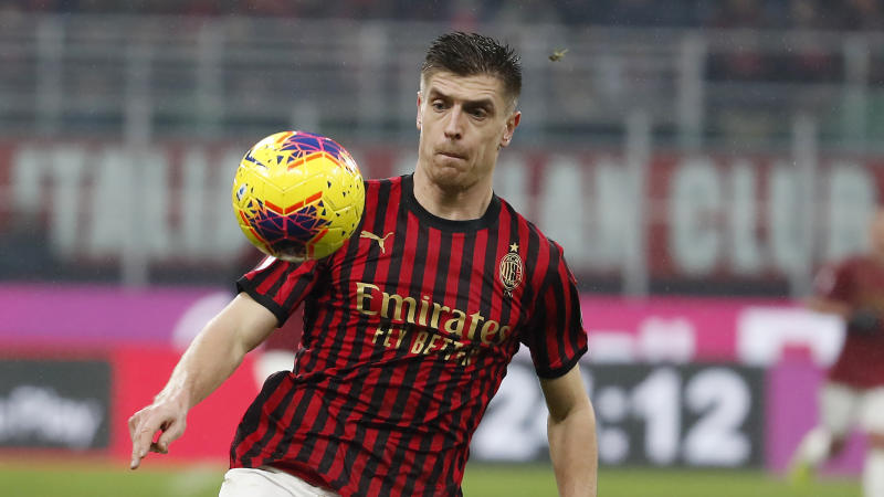 AC Milan's Krzysztof Piatek controls the ball during the Serie A soccer match between AC Milan and Sassuolo at the San Siro stadium, in Milan, Italy, Sunday, Dec. 15, 2019. (AP Photo/Antonio Calanni)