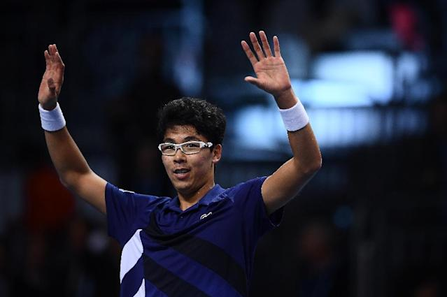Hyeon Chung of South Korea celebrates after his victory in a final against Andrey Rublev from Russia during the Next Generation ATP Finals in Milan on November 11, 2017 (AFP Photo/MARCO BERTORELLO)