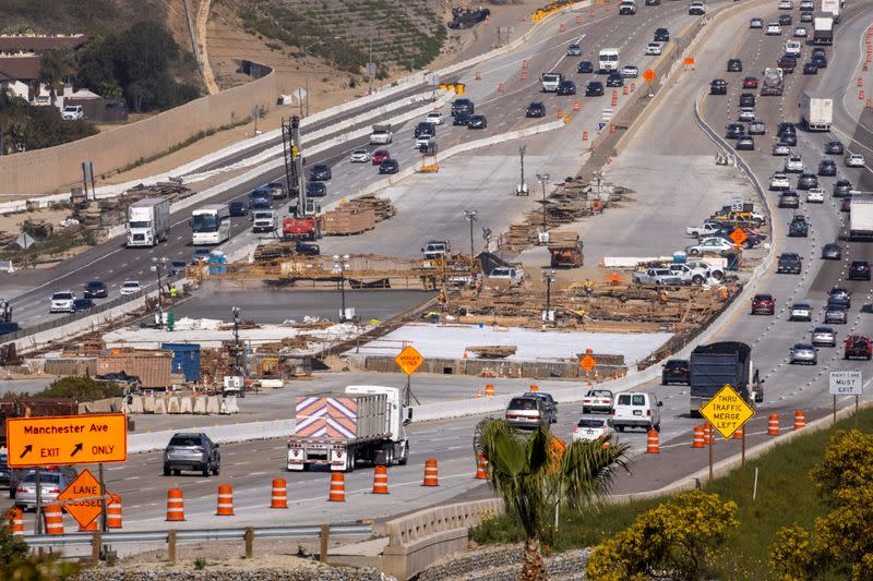Work crews continue to work on the construction of a freeway overpass in Encinitas