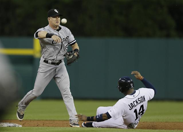 Chicago White Sox second baseman Gordon Beckham completes a double play as he tags Detroit Tigers' Austin Jackson and throws to first for the out on Ian Kinsler during the third inning of a baseball game, Wednesday, July 30, 2014 in Detroit. (AP Photo/Carlos Osorio)
