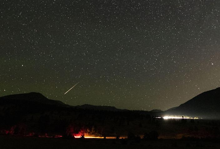 <p>A meteor shoots across the mountainscape at the Rocky Mountain National Park in Colorado. // August 13, 2018</p>